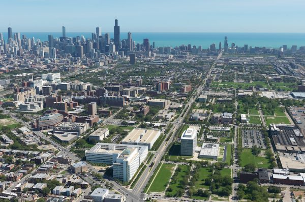 An aerial view of the Illinois Medical District, with the Chicago Loop and Lake Michigan in the background.