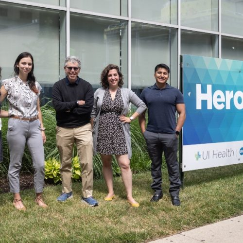 Members of UIC's contact tracing team pose for a photo outside a UI Health building.