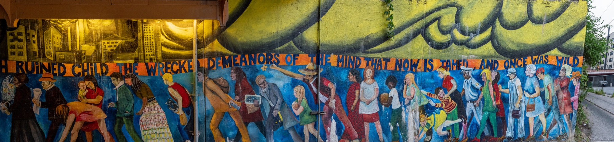 An underpass on Chicago's south side contains a mural showing a wide variety of people, with differences in age, size and ethnicities.